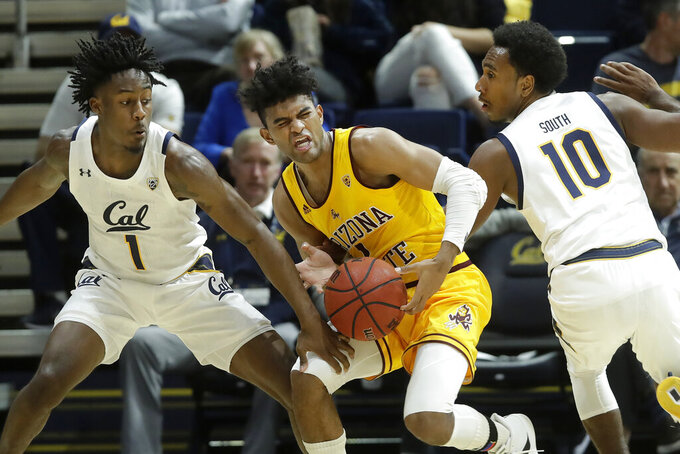 Arizona State guard Remy Martin, center, is defended between California guards Joel Brown, left, and Kareem South (10) during the first half of an NCAA college basketball game in Berkeley, Calif., Sunday, Feb. 16, 2020. (AP Photo/Jeff Chiu)
