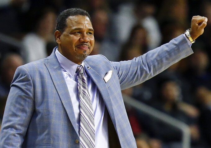 FILE - In this Feb. 23, 2019, file photo, Providence head coach Ed Cooley reacts during an NCAA college basketball game against Marquette in Providence, R.I. Providence President Rev. Brian Shanley announced Tuesday, May 21, 2019, that Cooley has agreed to a multiyear contract extension to remain with the Friars and withdrawn his name from consideration for the top job at Michigan. (AP Photo/Michael Dwyer, File)