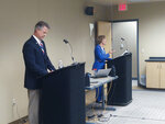 U.S. Rep. Roger Marshall, left, R-Kan., the GOP nominee for an open U.S. Senate seat, and state Sen. Barbara Bollier, D-Mission Hills, the Democratic nominee, participate in a debate, Saturday, Sept. 19, 2020, in Topeka, Kan. Marshall suggested that Bollier's election would help spur passage of Democrats' Green New Deal policies even though Bollier said she opposes them as unrealistic.(Greg Akagi/Alpha Media Topeka via AP)