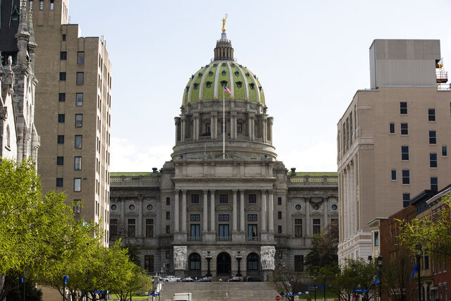 FILE - This Wednesday, April 10, 2019, file photo, shows the Pennsylvania Capitol in Harrisburg, Pa. More than a dozen Pennsylvania state legislators have announced they won't be seeking reelection in 2020. (AP Photo/Matt Rourke, File)