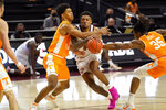 Texas A&M guard Savion Flagg (1) is fouled by Tennessee guard Jaden Springer (11) while driving the basket during the second half of an NCAA college basketball game Saturday, Jan. 9, 2021, in College Station, Texas. (AP Photo/Sam Craft)