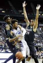 San Diego State's Jalen McDaniels, left, Nolan Narain, right, and Nevada's Jordan Brown get tangled up during the first half of an NCAA college basketball game in the Mountain West Conference men's tournament Friday, March 15, 2019, in Las Vegas. (AP Photo/Isaac Brekken)