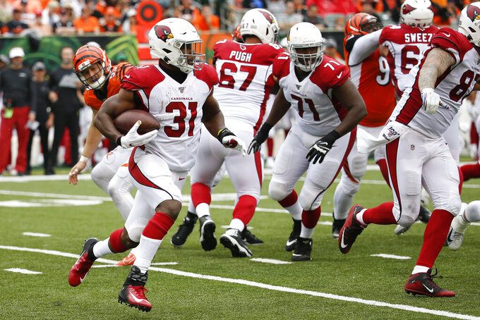 Arizona Cardinals running back David Johnson (31) runs the ball in the second half of an NFL football game against the Cincinnati Bengals, Sunday, Oct. 6, 2019, in Cincinnati. (AP Photo/Frank Victores)