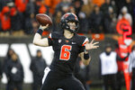 FILE - In this Nov. 23, 2018, file photo, Oregon State quarterback Jake Luton passes during an NCAA college football game in Corvallis, Ore. Jake Luton is determined to make the most of his last chance. After a career marred by injury, he was granted a sixth season of eligibility. (AP Photo/Timothy J. Gonzalez, File)