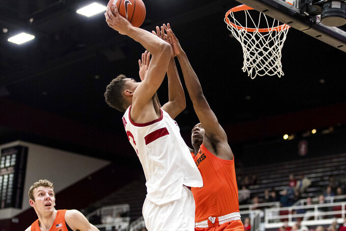 Stanford forward Oscar da Silva, left, shoots as Oregon State forward Alfred Hollins defends during the first half of an NCAA college basketball game Thursday, Jan. 30, 2020, in Stanford, Calif. (AP Photo/John Hefti)