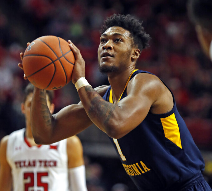 West Virginia's Derek Culver (1) shoots a free throw during the second half of an NCAA college basketball game against Texas Tech, Monday, Feb. 4, 2019, in Lubbock, Texas. (AP Photo/Brad Tollefson)