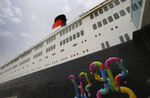 The Queen Elizabeth 2 is moored at the Rashid Port off the Mideast city-state of Dubai, United Arab Emirates, Tuesday, April 17, 2018. Britain's famed luxury cruise ship finally will have a soft opening Wednesday as a floating luxury hotel nearly a decade after arriving here following her last ocean voyage. (AP Photo/Kamran Jebreili)