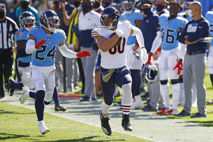 Chicago Bears tight end Jimmy Graham (80) gets past Tennessee Titans strong safety Kenny Vaccaro (24) in the first half of an NFL football game Sunday, Nov. 8, 2020, in Nashville, Tenn. (AP Photo/Wade Payne)