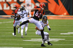 Cincinnati Bengals wide receiver Tyler Boyd (83) makes a catch in front of Jacksonville Jaguars free safety Andrew Wingard (42) in the second half of an NFL football game in Cincinnati, Sunday, Oct. 4, 2020. (AP Photo/Aaron Doster)