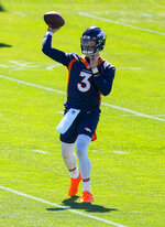 Denver Broncos quarterback Drew Lock (3) throws during OTAs at the team's headquarters Monday, May 24, 2021, in Englewood, Colo. (AP Photo/Jack Dempsey)
