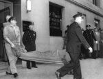 FILE - In this Oct. 25, 1957 file photo, the body of gangster Albert Anastasia is carried by stretcher from the A. Grasso barber shop in New York's Park Sheraton Hotel where he was slain by two masked gunmen in New York. While mob executions are a blast from the past; the last boss executed was Paul Castellano in 1985, on Wednesday, March 13, 2019, Francesco,