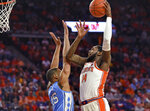 Clemson's Elijah Thomas, right, shoots over North Carolina's Garrison Brooks during the first half of an NCAA college basketball game Saturday, March 2, 2019, in Clemson, S.C. (AP Photo/Richard Shiro)
