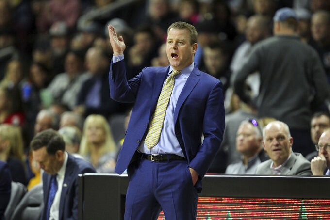 Marquette head coach Steve Wojciechowski yells instructions during the first half of an NCAA college basketball game against Providence Saturday, Feb. 22, 2020, in Providence, R.I. (AP Photo/Stew Milne)