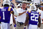 LSU head coach Ed Orgeron, center, congratulates running back Clyde Edwards-Helaire (22) after Edwards-Helaire scored a touchdown against Vanderbiltin the first half of an NCAA college football game Saturday, Sept. 21, 2019, in Nashville, Tenn. (AP Photo/Mark Humphrey)