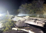 In this photo released by Kharkiv Regional State Administration, wreckage of an AN-26 military plane seen after it crashed in the town of Chuguyiv close to Kharkiv, Ukraine, late Friday, Sept. 25, 2020. A Ukrainian military plane carrying students at an aviation school crashed and burst into flames while landing, killing more than twenty people. Two other people on board were seriously injured and four people were missing. (Kharkiv Regional State Administration via AP)