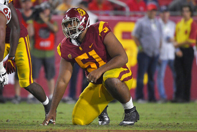 "FILE - In this Aug. 31, 2019, file photo, Southern California defensive lineman Marlon Tuipulotu gets ready to run a play during the second half of an NCAA college football game against Fresno State, in Los Angeles. Southern California assistant coach Chad Kauha'aha'a always knew defensive tackle Marlon Tuipulotu could be a special player. Kauha'aha'a believed it when he tried to recruit Tuipulotu to Oregon State, and he is seeing it in his first season working with the redshirt sophomore for the No. 24 Trojans. ""I knew he had the potential to be a great one,"" Kauha'aha'a said Wednesday night, Sept. 11, 2019. (AP Photo/Mark J. Terrill, File)"