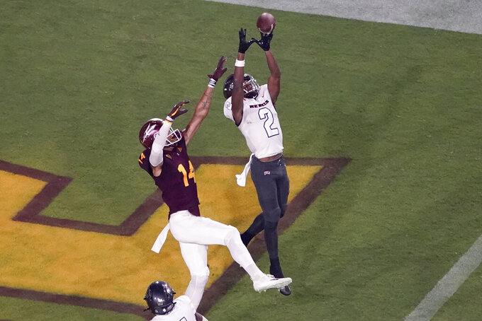 UNLV defensive back Nohl Williams (2) intercepts a pass in the end zone intended for Arizona State wide receiver Johnny Wilson (14) during the first half of an NCAA college football game, Saturday, Sept. 11, 2021, in Tempe, Ariz. (AP Photo/Matt York)