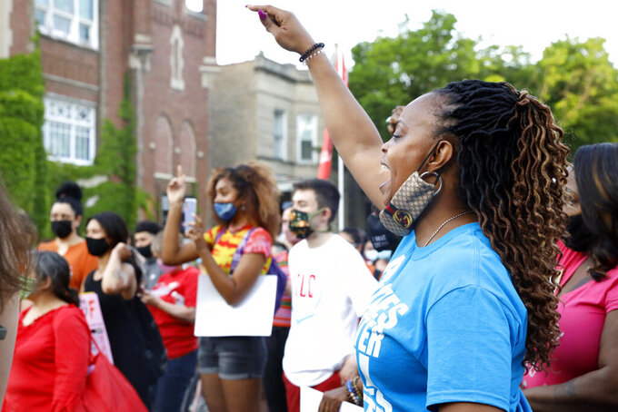 People gather to protest Chicago Mayor Lori Lightfoot's policies near her home on the two-year anniversary of her inauguration, Thursday, May 20, 2021 in Chicago. (AP Photo/Shafkat Anowar)