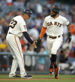 San Francisco Giants' Kevin Pillar, right, is congratulated by third base coach Ron Wotus (23) after hitting a home run off San Diego Padres' Joey Lucchesi during the second inning of a baseball game Wednesday, June 12, 2019, in San Francisco. (AP Photo/Ben Margot)