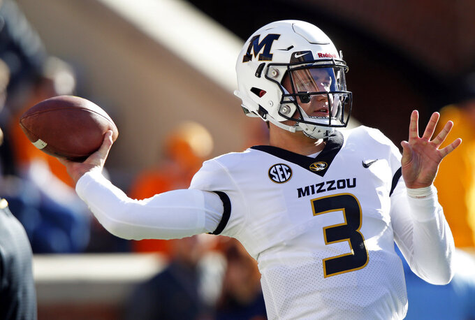 Missouri quarterback Drew Lock (3) throws during warmups before an NCAA college football game against Tennessee Saturday, Nov. 17, 2018, in Knoxville, Tenn. (AP Photo/Wade Payne)