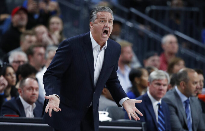 Kentucky's head coach John Calipari reacts after a play against Ohio State during the first half of an NCAA college basketball game Saturday, Dec. 21, 2019, in Las Vegas. (AP Photo/John Locher)