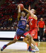 Arizona guard Justin Coleman (12) attempts to drive past Utah guard Parker Van Dyke (5) during the first half of an NCAA college basketball game Thursday, Feb. 14, 2019, in Salt Lake City. (AP Photo/Alex Goodlett)