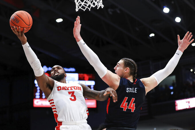 Dayton's Trey Landers (3) drives to the basket against Duquesne's Baylee Steele (44) in the first half of an NCAA college basketball game, Saturday, Feb. 22, 2020, in Dayton, Ohio. (AP Photo/Aaron Doster)