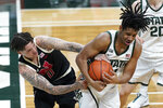Nebraska guard Teddy Allen (0) and Michigan State guard A.J. Hoggard (11) battle for a loose ball in the first half of an NCAA college basketball game in East Lansing, Mich., Saturday, Feb. 6, 2021. (AP Photo/Paul Sancya)