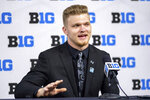 Michigan defensive end Aidan Hutchinson talks with reporters during an NCAA college football news conference at the Big Ten Conference media days, Thursday, July 22, 2021, at Lucas Oil Stadium in Indianapolis. (AP Photo/Doug McSchooler)