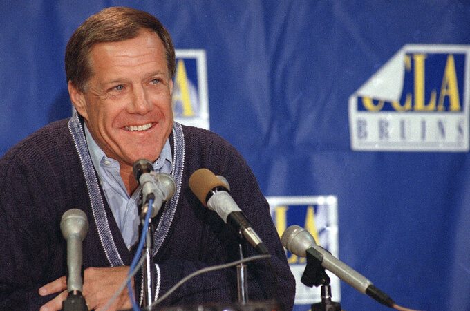 FILE - In this Dec. 11, 1995, file photo, Terry Donahue, the all-time leader in victories at UCLA and in the Pac-10, announces his resignation as head football coach, in Los Angeles. Donahue, the winningest coach in Pac-12 Conference and UCLA football history who later served as general manager of the NFL's San Francisco 49ers, died Sunday, July 4, 2021. He was 77. (AP Photo/Nick Ut, File)