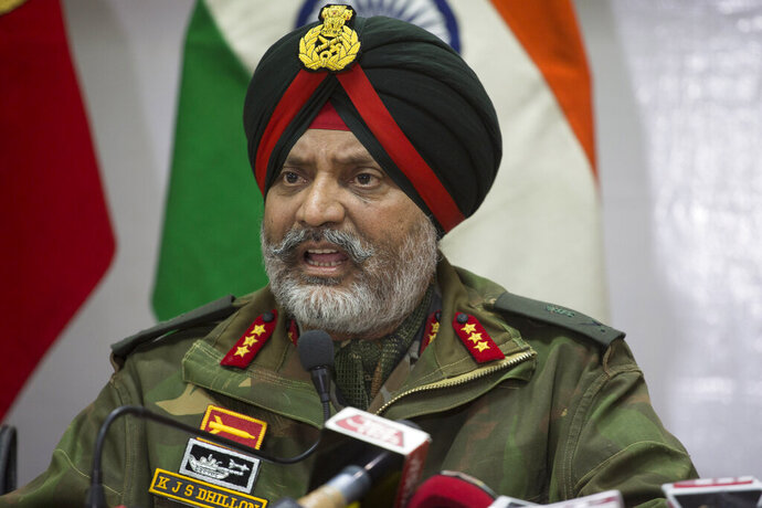 "Indian Army's General Officer Commanding of the Srinagar-based 15 Corps  Lt. Gen. K.J.S. Dhillon speaks during a joint press conference in Srinagar, Indian controlled Kashmir, Tuesday, Feb. 19, 2019. A top Indian military official in disputed Kashmir on Tuesday accused the Pakistani army and its spy agency for involvement in the last week's deadly car bombing. Dhillon told reporters in Srinagar, the main city of Indian-held Kashmir, that the leadership of Jaish-e-Mohammed militant group was ""eliminated within 100 hours"" of the Feb. 14 attack, linking the slain militants in Monday's gunbattle to the attack. (AP Photo)"