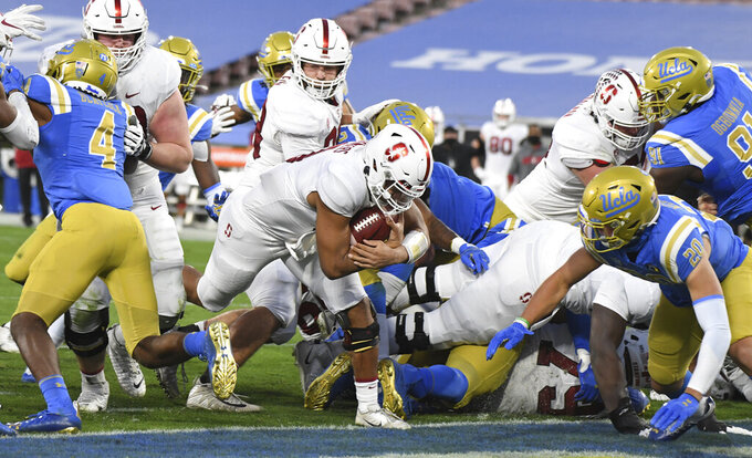 Stanford quarterback Isaiah Sanders runs for touchdown against UCLA Bruins during the first half of an NCAA college football game Saturday, Dec. 19, 2020, in Pasadena, Calif.  (Keith Birmingham/The Orange County Register via AP)