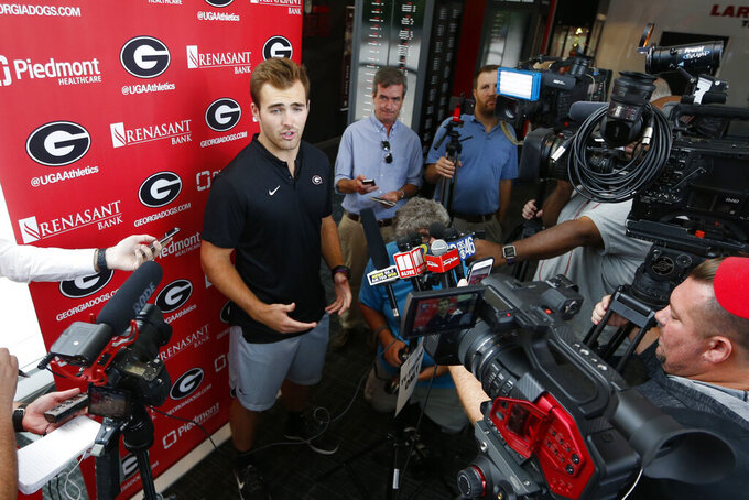 Georgia quarterback Jake Fromm speaks to reporters before the team's first scheduled NCAA college football practice Friday, Aug. 2, 2019, in Athens, Ga. (AP Photo/John Bazemore)