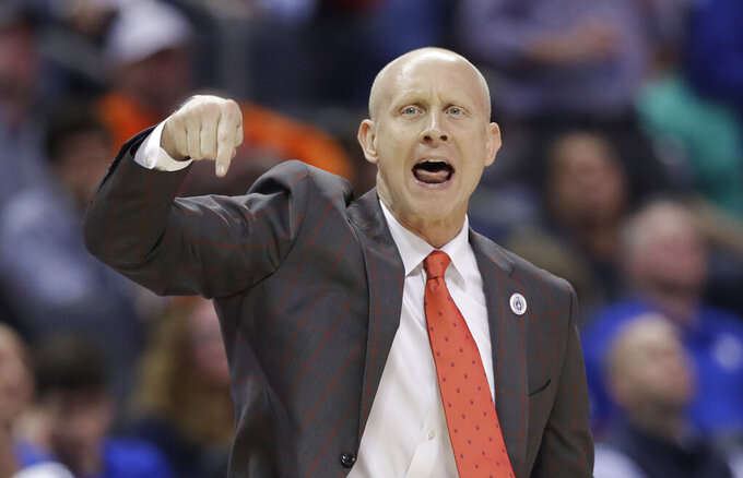 Louisville head coach Chris Mack reacts to a call during the second half of an NCAA college basketball game against North Carolina in the Atlantic Coast Conference tournament in Charlotte, N.C., Thursday, March 14, 2019. (AP Photo/Chuck Burton)
