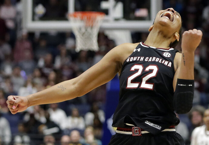 FILE - In this March 4, 2018, file photo, South Carolina forward A'ja Wilson celebrates after her team defeated Mississippi State in an NCAA college basketball championship game at the women's Southeastern Conference tournamen, in Nashville, Tenn. The 6-foot-5 senior became the first three-time Southeastern Conference player of the year and set South Carolina's career scoring mark while mentoring the next group of Gamecocks and thriving as the best women's college basketball player. Wilson, who was the No. 1 high school recruit, is a leading candidate to be named national player of the year.(AP Photo/Mark Humphrey, File)