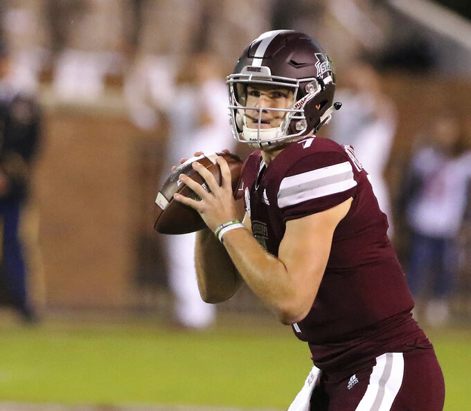 Mississippi State quarterback Nick Fitzgerald (7) looks for a receiver during the first half of their NCAA college football game against Texas A&M on Saturday, Oct. 27, 2018, in Starkville, Miss. MSU won 28-13. (AP Photo/Jim Lytle)