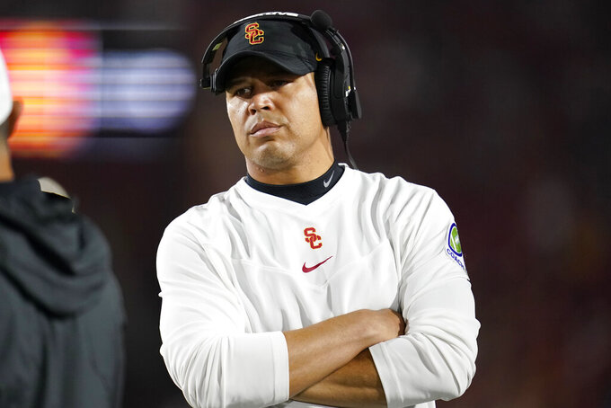 Southern California head coach Donte Williams walks on the sideline during the first half of an NCAA college football game against Oregon State Saturday, Sept. 25, 2021, in Los Angeles. (AP Photo/Marcio Jose Sanchez)