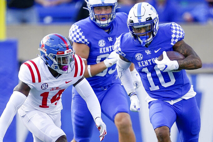 Kentucky running back Asim Rose (10) runs with the ball during the first half of an NCAA college football game against Mississippi, Saturday, Oct. 3, 2020, in Lexington, Ky. (AP Photo/Bryan Woolston)