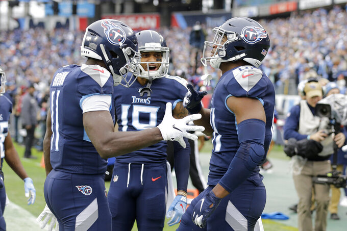 Tennessee Titans tight end Jonnu Smith, right, is congratulated after scoring at touchdown against the New Orleans Saints in the first half of an NFL football game Sunday, Dec. 22, 2019, in Nashville, Tenn. (AP Photo/James Kenney)