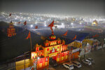 In this Monday, Jan. 14, 2019, photo, a thick layer of dust is seen over the tent city set up for the spiritual-cleansing Kumbh Festival in Prayagraj, India. The skies over the confluence of sacred rivers in north India where millions of Hindu priests and pilgrims have come to wash away their sins for the Kumbh Mela, or pitcher festival, that begins this week are thick with toxic dust, a sign that Indian government officials are struggling to grapple with India's worsening air pollution. (AP Photo/Rajesh Kumar Singh)