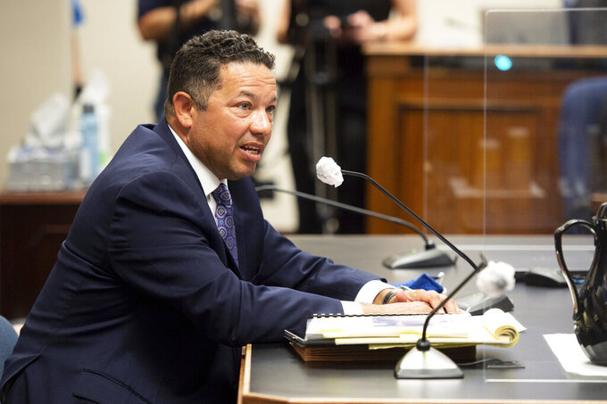 Winston DeCuir Jr., LSU Vice President of Legal Affairs and General Counsel, speaks at the Senate Select Committee on Women and Children at the Louisiana State Capitol in Baton Rouge, La. Thursday, April 8, 2021.  In a $50 million federal racketeering lawsuit, an associate athletic director at Louisiana State University accuses university officials of retaliating against her for reporting racist remarks and inappropriate sexual behavior by former head football coach Les Miles. (Scott Clause/The Daily Advertiser via AP)