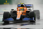 Mclaren driver Lando Norris of Britain steers his car during the qualifying session at the Sochi Autodrom circuit, in Sochi, Russia, Saturday, Sept. 25, 2021. The Russian Formula One Grand Prix will be held on Sunday. (AP Photo/Sergei Grits)