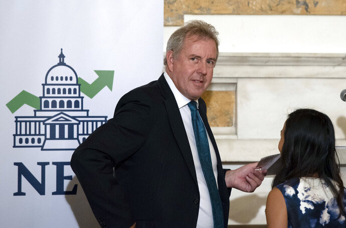 FILE - In this Friday, Oct. 20, 2017, file photo, British Ambassador Kim Darroch hosts a National Economists Club event at the British Embassy in Washington. Britain's ambassador to the United States resigned Wednesday, July 10, 2019, just days after diplomatic cables criticizing President Donald Trump caused embarrassment to two countries that often celebrate having a