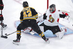 Ottawa Senators goaltender Craig Anderson, right, drops to his knees as Boston Bruins left wing Danton Heinen (43) sets up his goal during the third period of an NHL hockey game in Boston, Saturday, Nov. 2, 2019. (AP Photo/Charles Krupa)
