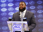 FILE - In this July 18, 2018, file photo, North Carolina's Aaron Crawford smiles as he answers a question during a news conference at the NCAA Atlantic Coast Conference college football media day in Charlotte, N.C. Crawford said there hasn't been any significant change to practice reps during preseason camp despite 13 players facing suspensions for secondary NCAA violations. (AP Photo/Chuck Burton, File)