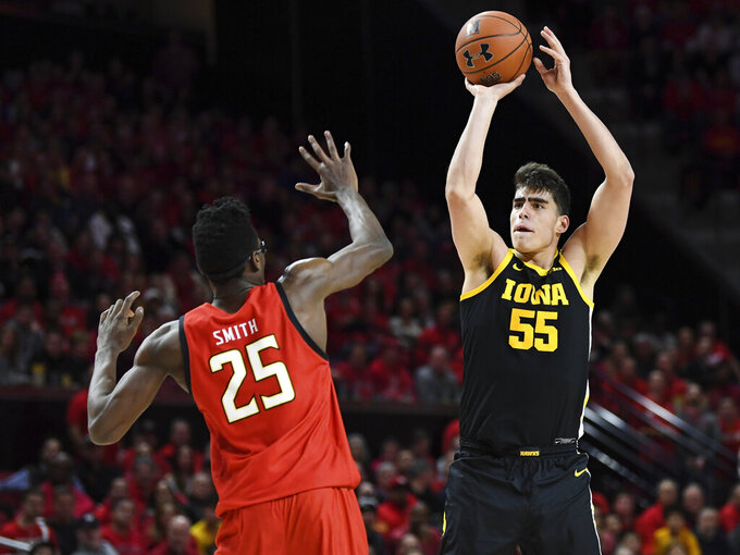 Iowa center Luka Garza (55) shoots over Maryland forward Jalen Smith (25) during the first half of an NCAA college basketball game Thursday, Jan. 30, 2020, in College Park, Md. (AP Photo/Terrance Williams)