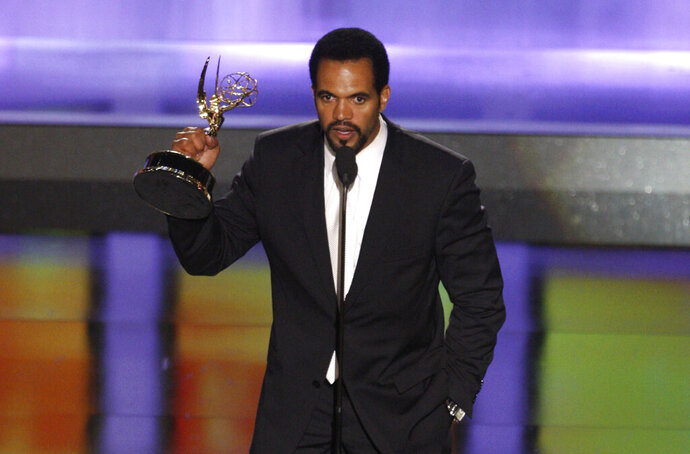 FILE - In this June 20, 2008, file photo Kristoff St. John accepts the award for outstanding supporting actor in a drama series for his work on