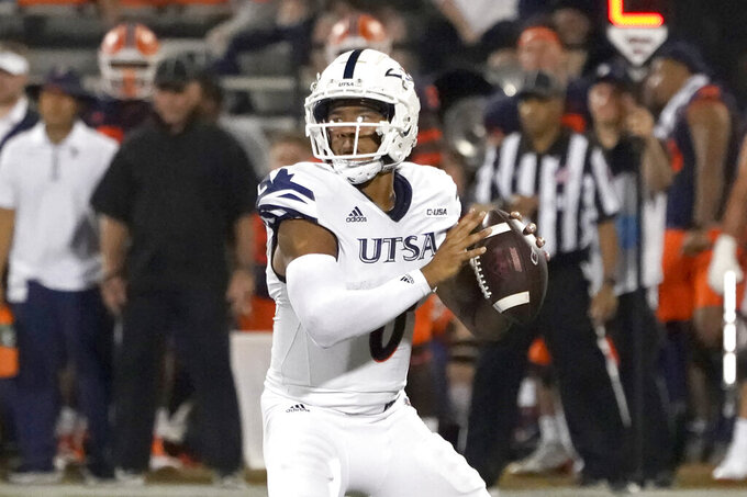 UTSA quarterback Frank Harris looks to pass during the first half of an NCAA college football game against Illinois, Saturday, Sept. 4, 2021, in Champaign, Ill. (AP Photo/Charles Rex Arbogast)
