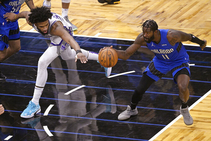 Orlando Magic forward James Ennis III (11) steals the ball from Sacramento Kings forward Marvin Bagley III (35) during the second half of an NBA basketball game Wednesday, Jan. 27, 2021, in Orlando, Fla. (AP Photo/Phelan M. Ebenhack)