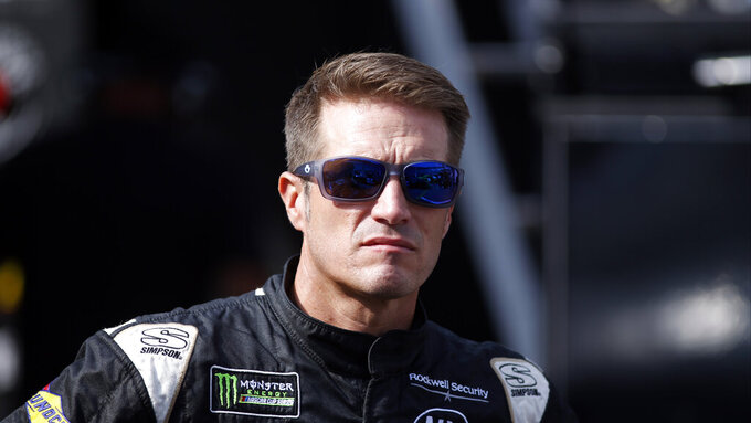 Driver JJ Yeley is seen in the pits before practice for an NASCAR Xfinity Series auto race on Thursday, Aug. 15, 2019, in Bristol, Tenn. (AP Photo/Wade Payne)